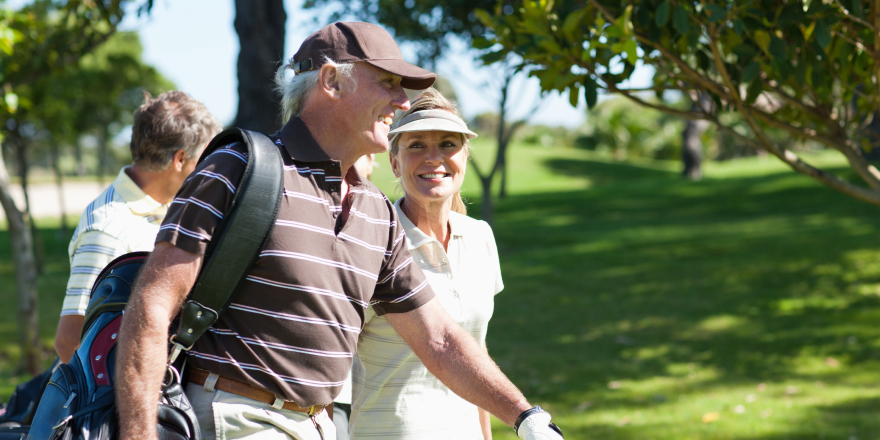 Couple Walking on Gulf Course